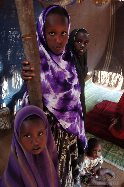 Habdi Yusuf, middle, stands with her siblings in their hut at Ifo Refugee Camp in Dadaab, Kenya September 12, 2006. ..Photograph by Erin Lubin