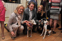 Left to right, CLARISSA BALDWIN Chief Executive Officer of Dogs Trust and ADRIAN & SARAH COOPER at The Dog's Trust Awards announcement held at George, 87-88 Mount Street, London on 27th March 2012.