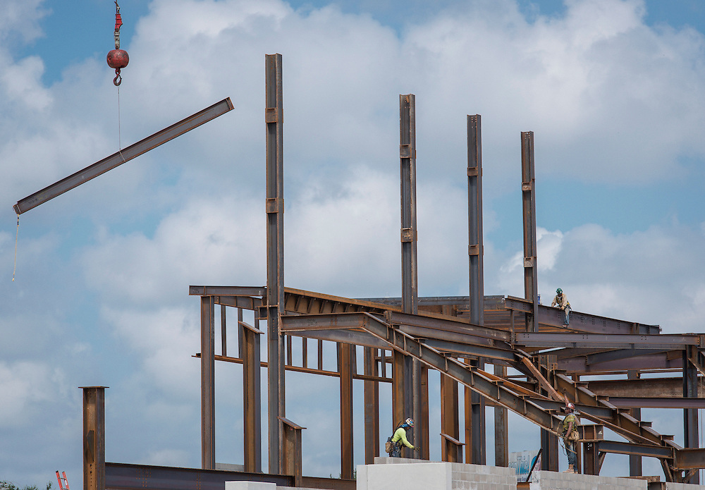 Construction crews work on the new Delmar-Tusa Fieldhouse, July 27, 2015.