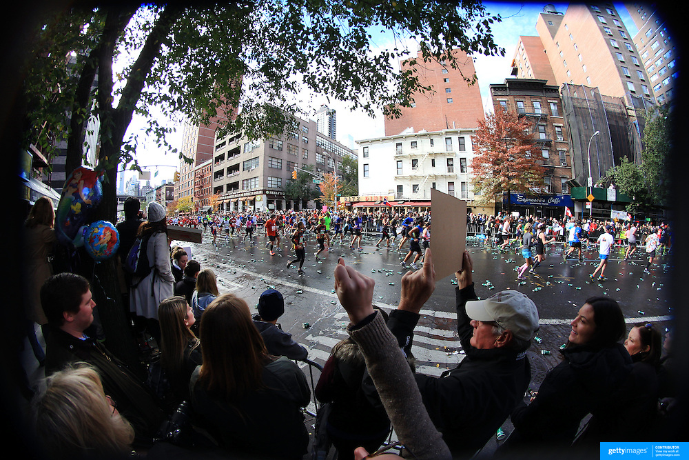 Spectators encourage runners make their way along First Avenue in Manhattan, New York, during the ING New York Marathon. New York, USA. 3rd November 2013. Photo Tim Clayton