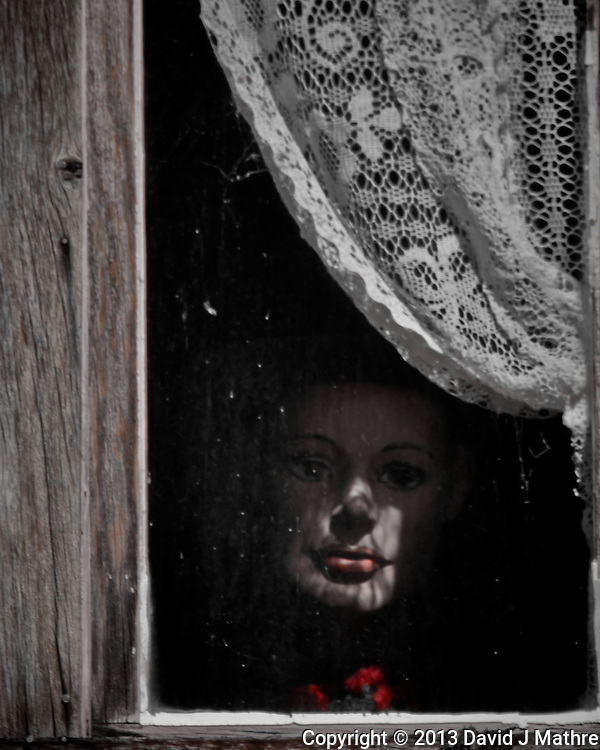 Face in a Window - St. Elmo Ghost Town in Colorado. Image taken with a Nikon 1 V2 camera, FT1 adapter, and 70-300 mm VR lens (ISO 160, 300 mm, f/16, 1/80 sec). Colorado Photo Safari with Jason Odell.