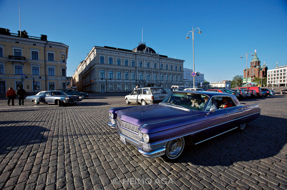 During summer from June to Septemper, every first Friday of the month is Vintage Car Cruising Night. Hundreds of classic American cars cruise around downtown Helsinki and meet at special places to have a good time, here at Kauppatori (Market Square), Uspenski orthodox cathedral in background. Cadillac DeVille sedan.