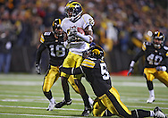 October 10, 2009: Michigan wide receiver Darryl Stonum (22) is hit by Iowa linebacker Bruce Davis (57) during the first half of the Iowa Hawkeyes' 30-28 win over the Michigan Wolverine's at Kinnick Stadium in Iowa City, Iowa on October 10, 2009.