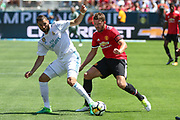 Real Madrid Forward Karim Benzema and Manchester United Midfielder Michael Carrick tackle during the AON Tour 2017 match between Real Madrid and Manchester United at the Levi's Stadium, Santa Clara, USA on 23 July 2017.