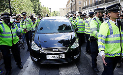 © Licensed to London News Pictures. 24/06/2016. London, UK. Boris Johnson's car is police escorted as he leaves home after the UK EU referendum result was announced with a victory for the leave campaign. Photo credit: Peter Macdiarmid/LNP