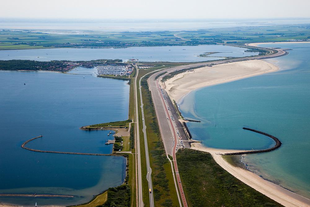 Nederland, Zuid-Holland, Ouddorp, 12-06-2009; de Brouwersdam, onderdeel van de Deltawerken, tussen Goeree en  Schouwen en (aan de horizon, provincie Zeeland), links het Grevelingenmeer en in het midden Middelplaat met recreatiecentrum en vakantiepark Port Zelande. .Na het afsluiten van de zeearm Grevelingen zijn gaandeweg ernstige milieuproblemen ontstaan in het zoetwater meer, er zijn plannen om een opening in de dam te maken om zo het getij deels terug te laten keren..Swart collectie, luchtfoto (25 procent toeslag); Swart Collection, aerial photo (additional fee required).foto Siebe Swart / photo Siebe Swart