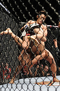 "LAS VEGAS, NEVADA, MAY 24, 2008: Dong Hyun Kim (facing) wrestles Jason Tan to the canvas during ""UFC 84: Ill Will"" inside the MGM Grand Garden Arena in Las Vegas"