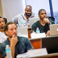 MIAMI, FL - June 24, 2015 -- NFL player Gerard Warren participate in a Legal & Ethical Implications of Executive Decision Making class taught by Professor Patricia Abril at the University of Miami as part of their Miami Executive MBA for Artists & Athletes program on Wednesday, June 24, 2015.  (PHOTO / CHIP LITHERLAND)
