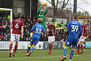 Northampton Town goalkeeper Richard O'Donnell (13) claiming the ball in front of AFC Wimbledon striker Lyle Taylor (33) during the EFL Sky Bet League 1 match between AFC Wimbledon and Northampton Town at the Cherry Red Records Stadium, Kingston, England on 10 February 2018. Picture by Matthew Redman.