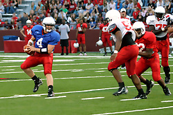18 AUG 2007:Drew Kiel works from outside the pocket, looking for a receiver. The Illinois State Redbirds, ranked in the top 10 in pre-season polls, prepare for the beginning of the season during the annual Red/White inter-squad scrimmage on the newly installed turf at Hancock stadium in Normal Illinois.