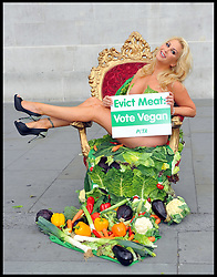 Victoria Eisermann Former Playboy model and Big Brother contestant  sits in the diary room chair outside the National Gallery, Trafalgar Square, London, covered by vegetables holding a sign reading 'Evict Meat: Vote Vegan', Monday June 25, 2012. Photo By Chris Joseph/i-Images