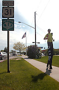 25 year old Neil Sauter walks along U.S. 31 toward downtown Charlevoix during his trek on stilts across Michigan to raise money and awarness for Cerebral Palsy.  Suater is walking from Toledo, Ohio to Ironwood, Michigan and hopes to raise $10,000.00.