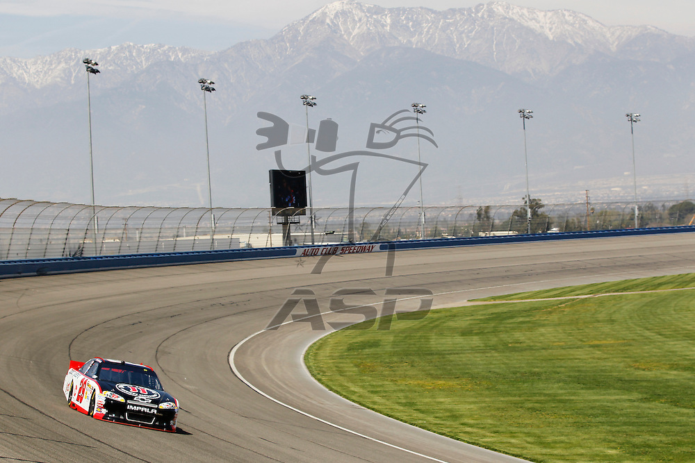 FONTANA, CA - MAR 23, 2012:  Kevin Harvick (29) brings his car through turn 4 during the Auto Club 400 at the Auto Club Speedway in Fontana, CA.