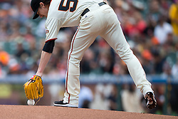 SAN FRANCISCO, CA - JUNE 25:  Tim Lincecum #55 of the San Francisco Giants picks up the baseball from the pitchers mound before the game against the San Diego Padres at AT&T Park on June 25, 2014 in San Francisco, California.  Tim Lincecum threw his second career no-hitter as the San Francisco Giants defeated the San Diego Padres 4-0.  (Photo by Jason O. Watson/Getty Images) *** Local Caption *** Tim Lincecum