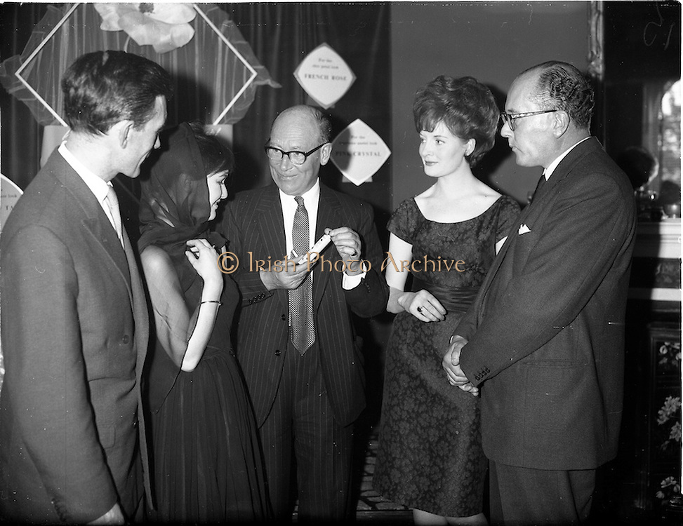 """07/06/1962<br /> 06/07/1962<br /> 07 June 1962 <br /> """"Light and Lovely"""" new Coty Make-up range, reception at the Shelbourne Hotel, Dublin. Discussing the new make-up were (l-r): Mr. C.J. Scanlan, Export Manager, Coty House, London; Miss Thora Ryan, model; Mr. N.R. Goodbody, Managing Director, Goodbody Ltd., Distributors; Miss Helen Joyce, model and Mr. M.F. Landon, Chief Perfumier, Coty House, London."""