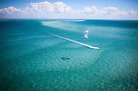White kite with kitesurfer over sea of blue in the Bazaruto archipelago, Mozambique