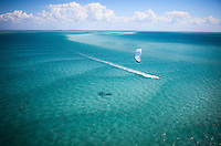 White kite with kitesurfer over sea of blue in the Bazaruto archipelago, Mozambique