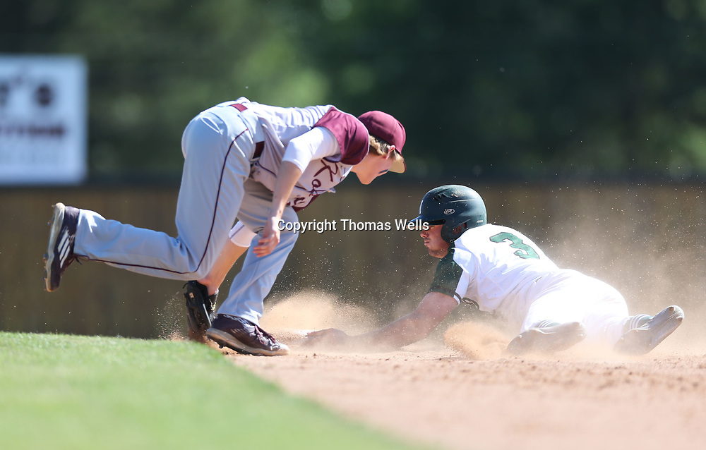 Mooreville's Trace Henry slides safely into second base on a steal attempt during their game three against Kossuth on Sunday.