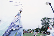 "Trinidad and Tobago ""MOKO JUMBIES: The Dancing Spirits of Trinidad"".(At Adam Smith Square, where she will take part in the Junior Individual competition, Ria Walters strolls by  in the ""Batimamselle"" costume, designed by Laura Anderson Barbata. She won first place.).A photo essay about a stilt walking school in Cocorite, Trinidad..Dragon Glen de Souza founded the Keylemanjahro School of Art & Culture in 1986. The main purpose of the school is to keep children off the streets and away from drugs..He first taught dances like the Calypso, African dance and the jig with his former partner Cathy Ann Samuel.  Searching for other activities to engage the children in, he rediscovered the art of stilt-walking, a tradition known in West Africa as the Moko Jumbies , protectors of the villages and participants in religious ceremonies. The art was brought to Trinidad by the slave trade and soon forgotten..Today Dragon's school has over 100 members from age 4 and up..His 2 year old son Mutawakkil is probably the youngest Moko Jumbie ever. The stilts are made by Dragon and his students and can be as high as 12-15 feet. The children show their artistic talents mostly at the annual Carnival, which today is unthinkable without the presence of the Moko Jumbies. A band can have up to 80 children on stilts and they have won many of the prestigious prizes and trophies that are awarded by the National Carnival Commission. Designers like  Peter Minshall , Brian Mac Farlane and Laura Anderson Barbata create dazzling costumes for the school which are admired by thousands of  spectators. Besides stilt-walking the children learn the limbo dance, drumming, fire blowing and how to ride  unicycles..The school is situated in Cocorite, a suburb of Port of Spain, the capital of Trinidad and Tobago..all images © Stefan Falke"