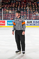 KELOWNA, CANADA - MARCH 9: Referee Brett Iverson stands on the ice at the Kelowna Rockets against the Kamloops Blazers on March 9, 2019 at Prospera Place in Kelowna, British Columbia, Canada.  (Photo by Marissa Baecker/Shoot the Breeze)