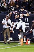 Chicago Bears wide receiver Tre McBride III (18) leaps and celebrates with Chicago Bears quarterback Mitchell Trubisky (10) after Trubisky runs for a successful two point conversion that ties the fourth quarter score at 17-17 during the 2017 NFL week 5 regular season football game against the against the Minnesota Vikings, Monday, Oct. 9, 2017 in Chicago. The Vikings won the game 20-17. (©Paul Anthony Spinelli)