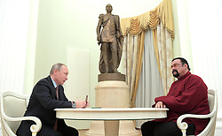 November 25, 2016 - Moscow, Russia - Russian President Vladimir Putin during a visit with American actor Steven Seagal in the Kremlin November 25, 2016 in Moscow, Russia. During the meeting Putin presented a Russian passport to Seagal making him a Russian citizen. (Credit Image: © Alexei Druzhinin/Planet Pix via ZUMA Wire)