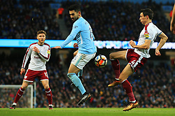 Ilkay Gundogan of Manchester City challenges Jack Cork of Burnley - Mandatory by-line: Matt McNulty/JMP - 06/01/2018 - FOOTBALL - Etihad Stadium - Manchester, England - Manchester City v Burnley - Emirates FA Cup Third Round