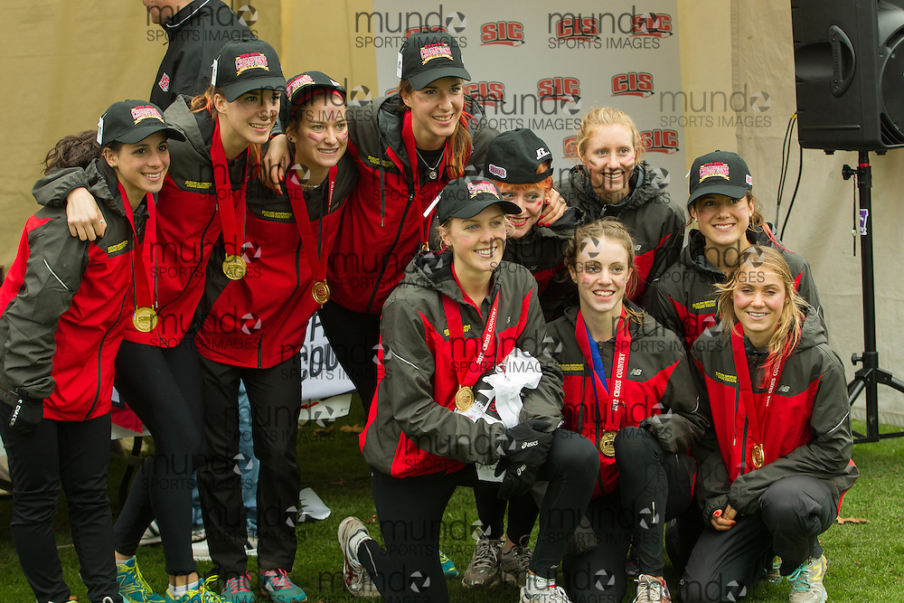 London, Ontario ---2012-11-10--- The Guelph Gryphons women's team poses with their gold medals following their victory at the 2012 CIS Cross Country Championships at Thames Valley Golf Course in London, Ontario, November 10, 2012. .GEOFF ROBINS Mundo Sport Images