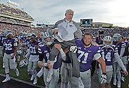 Head coach Bill Snyder (C) of the Kansas State Wildcats gets carried off the field, after winning his 200th career game at Kansas State, after a game against the Kansas Jayhawks at Bill Snyder Family Stadium in Manhattan, Kansas.
