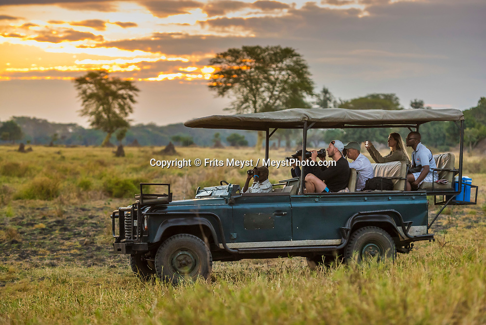 Malawi, July 2017. A landrover with tourists in the sunset. FRom Mvuu Lodge one can explore Liwonde National Park through game drives and boat safari. Malawi is known for its long rift valley and the third largest lake in Africa: Lake Malawi. Malawi is populated with friendly welcoming people, who gave it the name: the warm heart of Africa. In the south the lake make way for a landscape of valleys surrounded by spectacular mountain ranges. Photo by Frits Meyst / MeystPhoto.com