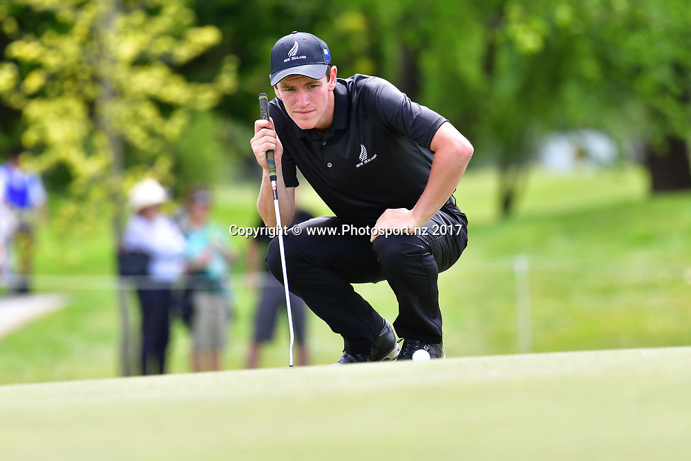 New Zealand's Kerry Mountcastle lines up a putt on the 18th during the final day of the Asia-Pacific Amateur golf Championship at the Royal Wellington Golf course in Upper Hutt on Sunday the 29 October 2017. Copyright Photo by Marty Melville / www.Photosport.nz