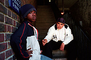 Two young teenage boys sharing a joint on the stairs of a housing estate Lambeth Walk South London c.2000