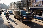 In Amsterdam rijden verschillende verkeersdeelnemers over het Damrak. Het Damrak is onlangs opnieuw ingericht met een duidelijkere scheiding tussen fietsers, trams en auto's.<br /> <br /> In Amsterdam all kinds of traffic ride on the Damrak. The Damrak is newly redesigned with a clearer separation between cyclists, trams and cars.