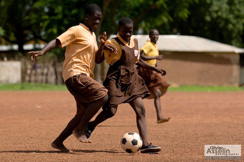 Girls play football (soccer) outside the Savelugu Junior Secondary School in Savelugu, Ghana on Tuesday June 5, 2007.
