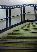 © Licensed to London News Pictures. 02/12/2012. London, UK The 160 steps to the platforms retain their original features and tiles, though some of the paintwork is deteriorating. London Transport Museum held tours, today 2nd December 2012, of Aldwych Tube Station, one of London's closed underground stations. Visitors were give a rare chance to glimpse what happens to a station after the public leave. The tour included a platform closed in 1914 which was used as a store for the National Gallery during the 2nd World War, amongst items stored were the Elgin Marbles. The station was used by 1000's of Londoners during the blitz as an air raid shelter. The station is often used for filming with films such as Atonement, V for Vendetta, Superman 4 and 28 weeks later. Photo credit : Stephen Simpson/LNP
