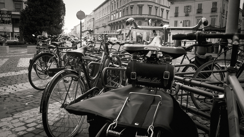 Bicycles at the Piazza Felice Cavallotti, Mantova Italy. A series of captures from a personal trip to the cities of Milan and Mantua, featuring explorations of Renaissance architecture and the vibrant life of Italian streets.