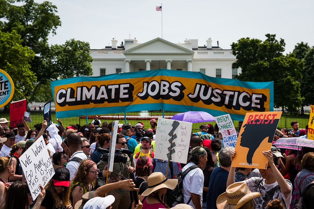 People taking part in the Climate March pass the White House in Washington, D.C. on April 29, 2017. CREDIT: Mark Kauzlarich for CNN