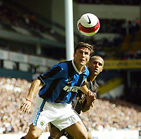 Photo: Chris Ratcliffe.<br /> Tottenham Hotspur v Inter Milan. Pre Season Friendly. 28/07/2006.<br /> Wayne Routledge of Spurs (R) tssles with Javier Zanetti of Inter