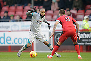 Dominic Vose attacking with Jimmy Smith defending during the EFL Sky Bet League 2 match between Crawley Town and Grimsby Town FC at the Checkatrade.com Stadium, Crawley, England on 26 November 2016. Photo by Jarrod Moore.