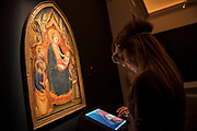 Mariotto di Nardo, THE MADONNA AND CHILD ENTHRONED, WITH SAINT PETER, SAINT JOHN THE BAPTIST, SAINT CATHERINE OF ALEXANDRIA AND ONE OTHER FEMALE SAINT AND ANGELS, £200,000-300,000 - London Old Masters Evening sale exhibition at Sotheby's New Bond Street. The sale takes palce on 6 December 2017 covers 400 years of art history.