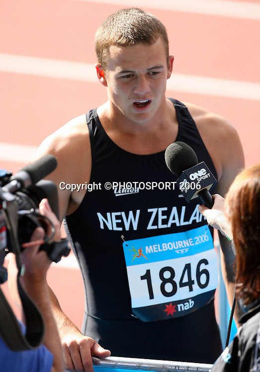 New Zealand athlete Brent Newdick (NZL) is interviewed after the Decathlon 100M sprint on Day 5 of the XVIII Commonwealth Games at the Exhibition Centre, Melbourne, Australia on Monday 20 March, 2006. Photo: Hannah Johnston/PHOTOSPORT<br />