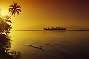 Sunset, Motu (island) off Moorea, French Polynesia<br />