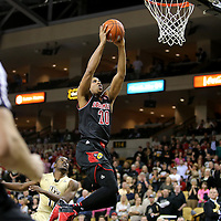 Louisville Cardinals guard/forward Wayne Blackshear (20) slams the ball during the first period during an NCAA basketball game between the 14th ranked Louisville Cardinals and the UCF Knights at the CFE Arena on Tuesday, December 31, 2013 in Orlando, Florida. (AP Photo/Alex Menendez)