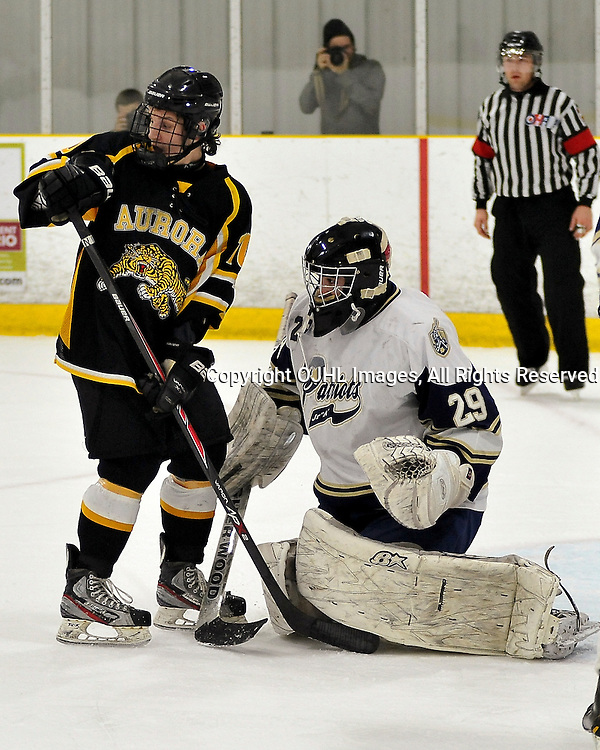 TORONTO, ON - Apr 13: Ontario Junior Hockey League, Buckland Cup Championship Series between the Aurora Tigers and the Toronto Patriots. Drake Board #10 of the Aurora Tigers attempts to screen Evan Buitenhuis #29 during the first period.<br /> (Photo by Shawn Muir / OJHL Images)