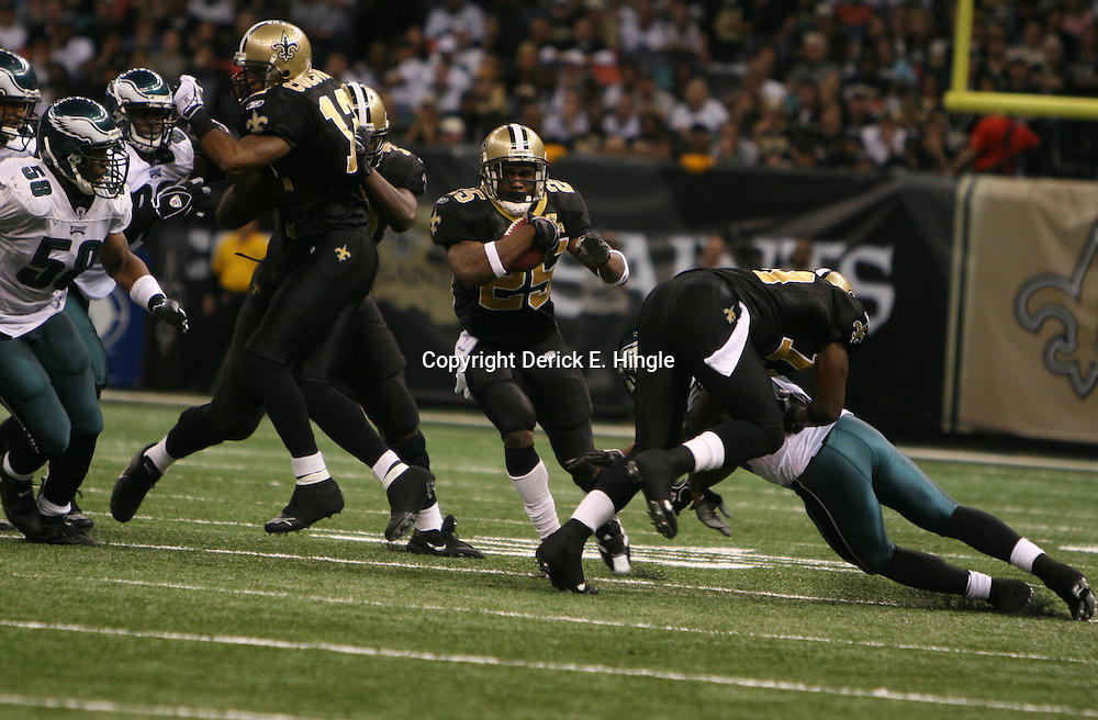 13 January 2007: New Orleans Saints running back Reggie Bush (25) runs through a hole during a 27-24 win by the New Orleans Saints over the Philadelphia Eagles in the NFC Divisional round playoff game at the Louisiana Superdome in New Orleans, LA. The win advanced the New Orleans Saints to the NFC Championship game for the first time in the franchise's history.