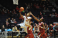 "Mississippi's Tia Faleru (32) scores against Arkansas' Kelsey Brooks (15) and Arkansas' Jessica Jackson (00) at the C.M. ""Tad"" Smith Coliseum in Oxford, Miss. on Friday, January 2, 2015. (AP Photo/Oxford Eagle, Bruce Newman)"