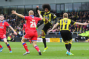 Burton Albion midfielder Hamza Choudhury stretches with a high foot in a challenge with Oldham forward Curtis Main during the Sky Bet League 1 match between Burton Albion and Oldham Athletic at the Pirelli Stadium, Burton upon Trent, England on 26 March 2016. Photo by Aaron Lupton.