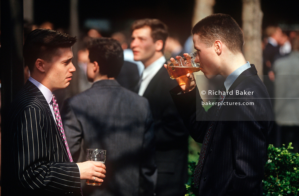 Two young 1990s city workers drink pints of beer outside a pub in the City of London (aka The Square Mile), the capital's financial centre, on 20th May 1993, in London, England. (Photo by Richard Baker / In Pictures via Getty Images)