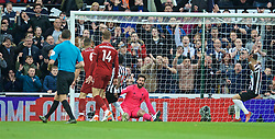 NEWCASTLE-UPON-TYNE, ENGLAND - Saturday, May 4, 2019: Newcastle United's Christian Atsu scores the first equalising goal during the FA Premier League match between Newcastle United FC and Liverpool FC at St. James' Park. (Pic by David Rawcliffe/Propaganda)