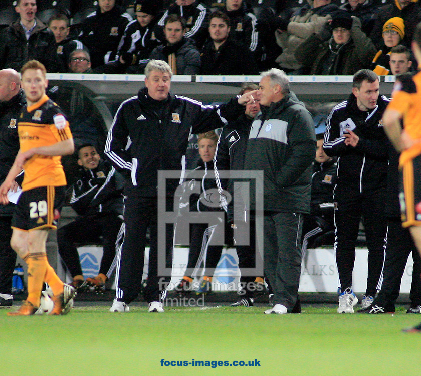 Picture by Richard Gould/Focus Images Ltd +447814 482222.12/01/2013.Steve Bruce manager (L) of Hull City shares a joke with Dave Jones manager of Sheffield Wednesday during the npower Championship match at the KC Stadium, Kingston upon Hull.